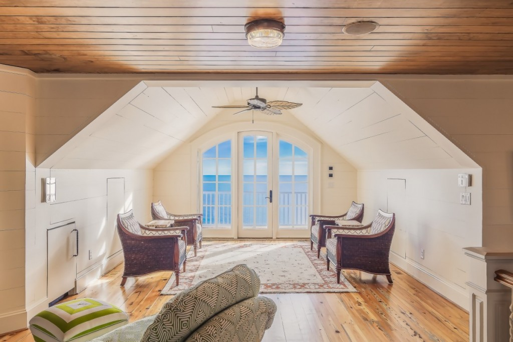 an image of a converted attic overlooking the ocean and with modern decor